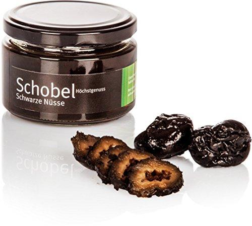 Preisvergleich Produktbild Eingelegte Schwarze Nüsse - Walnüsse nach altem Rezept - in einen süßen Kräutersirup eingelegte Schwarze Nüsse
