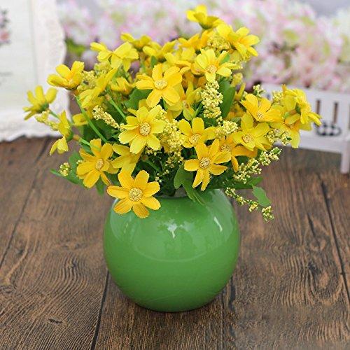 Eine moderne, minimalistische Möbel orb Vasen Schreibtisch verbringen eine kleine frische Blumen Emulation Suite Wohnzimmer setup für, wie Blumen.