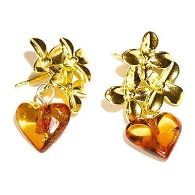 Boucles d'oreilles avec des fleurs dorées et des coeurs naturels d'ambre