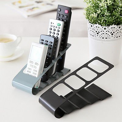 R Dabhi Metal Remote Control Organizer Stand Shelf Rack Holder Universal TV/Ac/ CD player (1 Pc)....  available at amazon for Rs.210