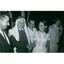 Yael Dayan is the daughter of Moshe Dayan; is greeting a leader of Saudian National.