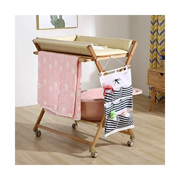 Wood Baby/Infant Changing Tables On Wheels, Folding Diaper Organizer Station with Storage, Table Height Adjustable (Color : White) GUYUE Beech Material: Birch wood hard, good load bearing performance, no deformation, strong pressure resistance, clear texture. High-grade PU Leather: It has excellent wear resistance, excellent breathability, aging resistance, soft and comfortable. Size: As shown, 80x56x(80-85-90-95)cm, Bearing weight 150kg. 3