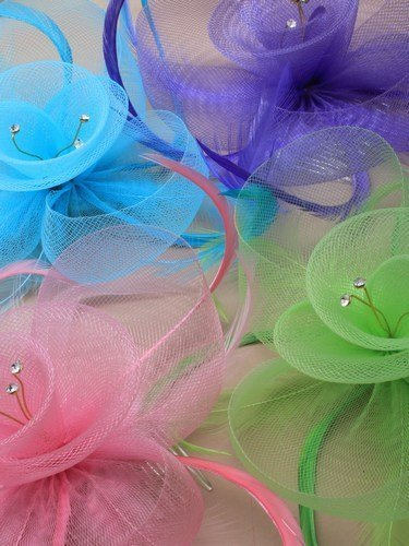 crysta-innovations-ref-4321-aqua-coloured-net-and-feather-crystal-centre-fascinator-on-clear-comb