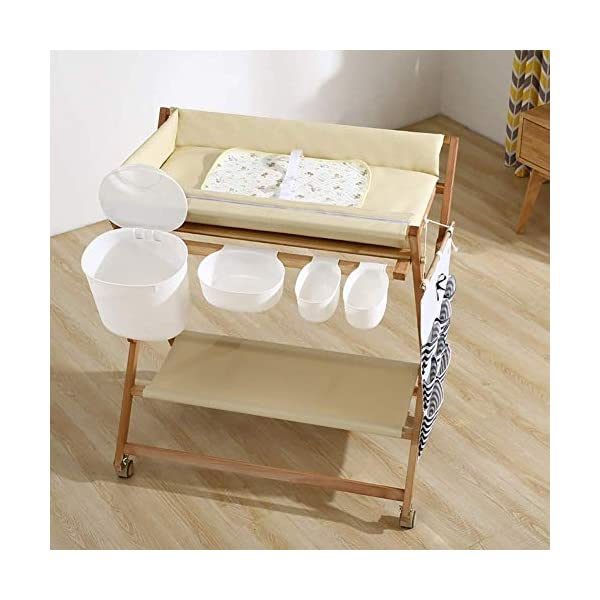 Wooden Baby Diaper Changing Table Folding Care Station with Casters, Storage and Cushion, Nursery Organizer for Small Space (Color : White) GUYUE Beech Material: Birch wood hard, good load bearing performance, no deformation, strong pressure resistance, clear texture. High-grade PU Leather: It has excellent wear resistance, excellent breathability, aging resistance, soft and comfortable. Size: As shown, 80x56x(80-85-90-95)cm, Bearing weight 150kg. 1