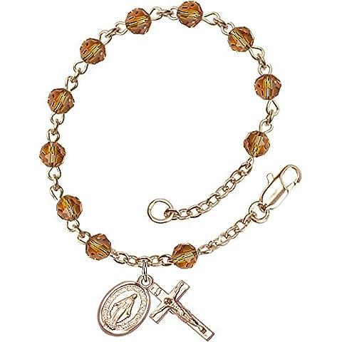 14Ct en oro en forma de rosario pulsera elástica de bolas con características 5 mm cuentas de Swarovski topacio. El crucifijo mide 5/8 x 1/4.