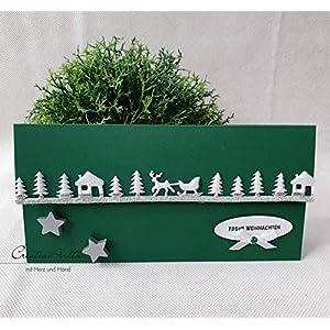 Gutschein- oder Geldgeschenkverpackung zu Weihnachten mit Waldbordüre in Dunkelgrün-Weiß