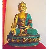 Hermosa de Buda de la medicina de la India con incrustaciones de piedras preciosas de túnica y Pedestal; Altura 31 cm por 21 cm de ancho; Peso 4,959 kilos. El Buda es el Buda de la medicina curativa - la manifestación de la energía curativa de todos los seres iluminados - Vendido por los dones espirituales. El envío suele tardar unos 2 días hábiles.