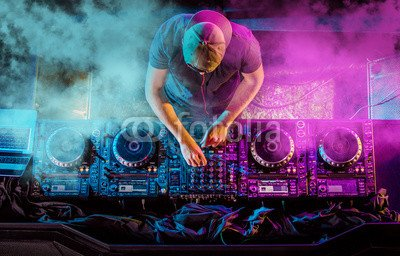 Wunschmotiv: Charismatic disc jockey at the turntable. DJ plays on the best, famous CD players at nightclub during party. EDM, party concept. #110110063 - Bild hinter Acrylglas - 3:2 - 60 x 40 cm / 40 x 60 cm