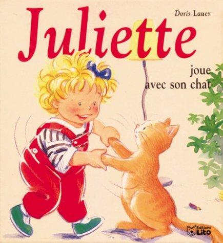 Juliette joue avec son chat