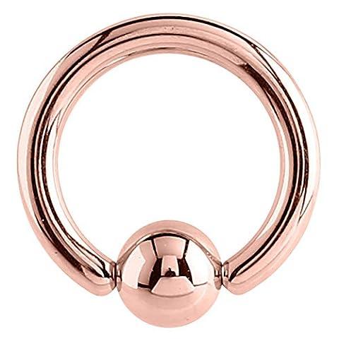 En acier de couleur or rose BCR. Calibre 1,2mm, diamètre interne 6mm. Anneau boule. Bonne pour le nez, tragus, Pinna, oreille, sourcils.