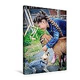 Premium Textil-Leinwand 50 cm x 75 cm hoch, Mädchen spielt mit der Ziege und einem Hund | Wandbild, Bild auf Keilrahmen, Fertigbild auf echter Leinwand, Leinwanddruck (CALVENDO Menschen)