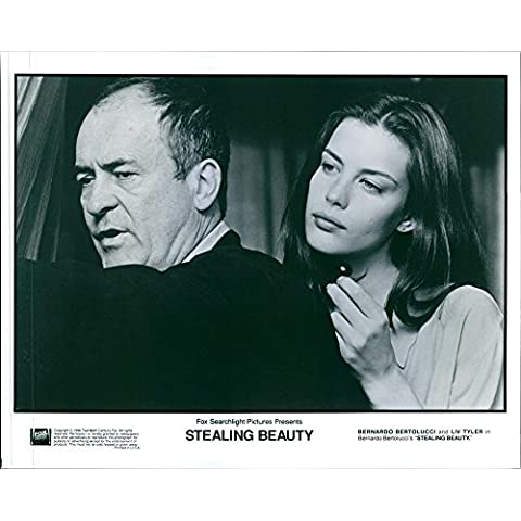 Vintage photo of 1996A scene photo of Bernando Bertolucci and Liv Tyler in the film