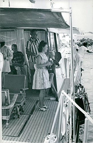 vintage-photo-of-princess-margaret-holding-a-camera-on-a-yacht