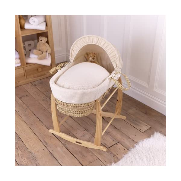 Clair de Lune Deluxe Rocking Moses Basket Stand (Natural)  A sturdy pine Moses basket stand rocks gently side to side to help soothe your baby to sleep. Adjustable plastic retaining bars ensure that your basket is securely held in place. Comes complete with stoppers so the basket can be locked into a stationary position. 2