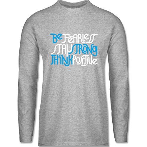 Shirtracer Statement Shirts - Fearless Strong Positive - Herren  Langarmshirt Grau Meliert. Das langärmelige Shirt der Marke B&C für ...