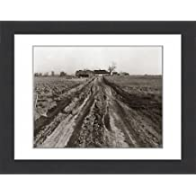 Framed Print of Dirt Road Leading Up To Old Farm House Surrounded