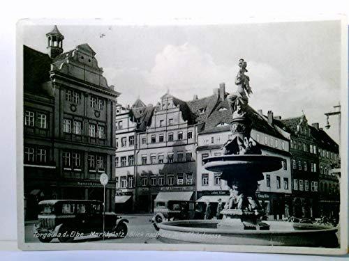 Torgau an der Elbe. Seltene AK. Marktplatz, Blick nach der Scheffelstrasse. Brunnen mit Statue, Straßenpartie, Gebäudeansichten, Autos, Geschäfte, Personen