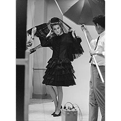 Jean Rosemary Shrimpton wearing a black dress.