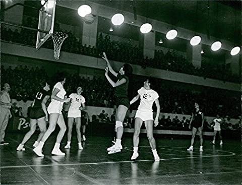 Vintage photo of Players playing basket ball in