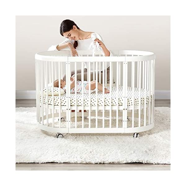 DUWEN-Cot bed Solid Wood Multifunction Baby Cot European Style Cot Bed Toddler Bed Splicing Bed Round Bed With Wheel (color : White) DUWEN-Cot bed 1. This multi-functional crib is made of environmentally-friendly eucalyptus, which is tough and durable, not easy to crack, bearing more than 80KG, green non-toxic paint, healthy and environmentally friendly, non-irritating, harmless to the baby, mother can buy with confidence 2. The three pedestal positions of the crib are suitable for the baby's growth stage, improving visibility and ventilation in all directions, selecting the gear according to the baby's body and age, making the space bigger and more comfortable to use. 3. Multi-functional crib can be easily converted into a game bed, sofa bed, writing desk, designed for healthy sleep of 0-6 years old baby (additional function can be used up to 6 years old), 55mm safety standard guardrail spacing, children's hands and feet will not be Stuck 3