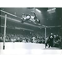 Vintage photo of Olympic athlete John Thomas jumping the bar,