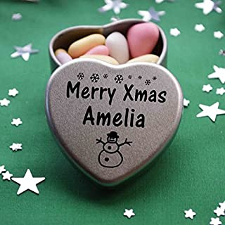 Merry Xmas Amelia Mini Heart Gift Tin with Chocolates Fits Beautifully in the palm of your hand. Great Christmas Present for Amelia Makes the perfect Stocking Filler or Card alternative. Tin Dimensions 45mmx45mmx20mm. Three designs Available, Father Christmas, Snowman and Snowflakes. They also make perfect Secret Santa Gifts.