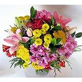 Ramo de flores variadas como margaritas, lilium y alstroemeria. No incluye jarron. Nosotros sólo nos hacemos cargo de los ramos vendidos y gestionados por Regalaunaflor.
