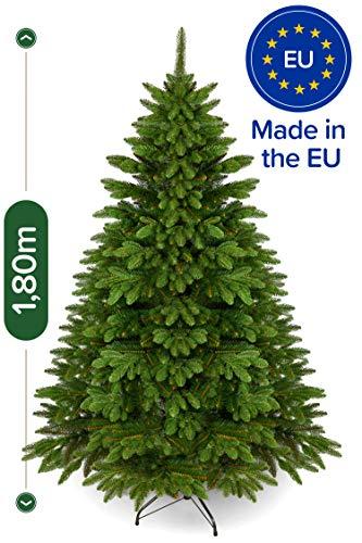 Weihnachtsbaum künstlich 180 cm - Edle Nordmanntanne mit Weihnachtsbaumständer - Künstlicher Premium Tannenbaum mit besonders dichten Zweigen - Exklusives Markenprodukt - Naturgetreu, Made in EU