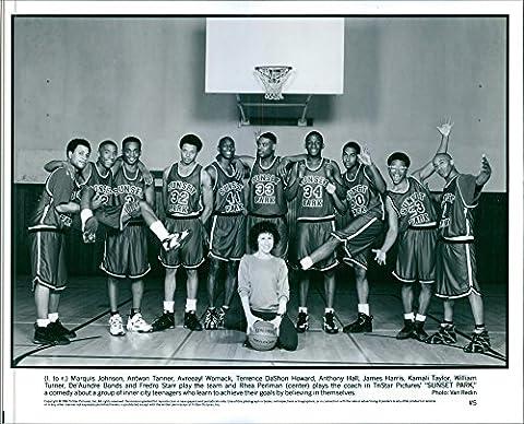 Vintage photo of Basketball team with coach Rhea Perlman, striking
