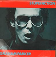 GRAHAM PARKER Stupefaction (1980 UK Stiff label solid centre 7 vinyl single also including Women In Charge housed in a fully laminated picture sleeve. There are two areas of laminate lift to the bottom edge of the sleeve and despite a couple of minor...