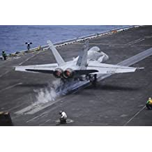 Stocktrek Images – An F/A-18C Hornet launches from the aircraft carrier USS Nimitz. Photo Print (86,87 x 57,91 cm)