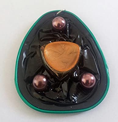 Pendentif en capsule de thé