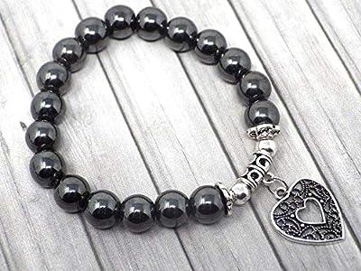 Bracelet pour femme en perles d'hématite noire avec une pampille plaquée argent filigranée en forme de cœur