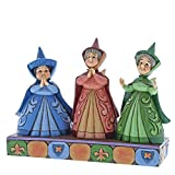Sleeping Beauty's three good fairies beam with pride as they watch their dear Aurora and her handsome prince waltz around the ballroom. This piece features Flora, Fauna and Merryweather in their signature dresses and delicate wings. The figurine is m...