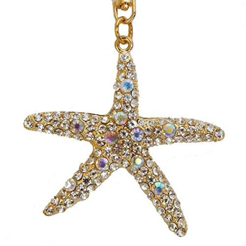 Utrendo llavero y adorno para bolsos. Elegante y precioso talismán dorado en forma de estrella de mar con brillantes y piedras de colores