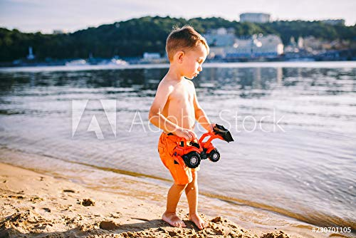 druck-shop24 Wunschmotiv: Caucasian Child Boy Playing Toy red Tractor, Excavator on a Sandy Beach by The River in red Shorts at Sunset Day #230701105 - Bild auf Leinwand - 3:2-60 x 40 cm / 40 x 60 cm - Echte Boys Shorts