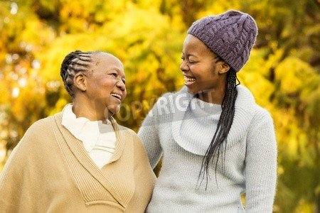"""Poster-Bild 50 x 30 cm: """"Mother and grandmother smiling to each other in parkland"""", Bild auf Poster"""