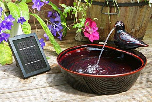 Fuente solar decorativa, cerámica, diseño de paloma
