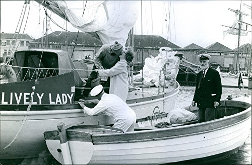 vintage-photo-of-man-kissing-wife-from-a-navy-transport-boat-visiting-him-his-anchored-at-plymouth-n