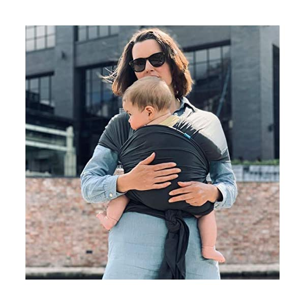We Made Me Flow, Super Stretchy, Cool & Comfortable Baby Carrier for Infants from 3.6-15.9 kg, Midnight Black Diono Nurture Your Bond From Birth: Low helps to build on your natural bond, hands free and while on the go, helping new parents to keep that close connection after birth all the way up to 15.5 kg The Lightest Wrap of It's Kind: The super flexible construction makes Flow one of the lightest soft carrier wraps on the market (0.58 kg versus 0.8 kg in average) Breathable Air Flow Mesh: The self-regulating air flow mesh material helps to keep you and baby cool and comfortable, perfect for the hot summer months 10