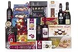 Lote de navidad con ibéricos de bellota, vinos y licores variados, conservas y amplio surtido de turrones y dulces navideños.