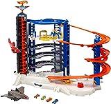 Hot Wheels FDF25 - Super Megacity Parkgarage, Garage und Parkhaus mit Gorilla und Flugzeug für +140 Spielzeugautos inkl. 4 Autos, ca. 107 cm hoch, Spielzeug ab 5 Jahren
