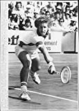 Vintage photo of Brian Gottfried in action during the match against Patrice Dominguez in French Open 1977