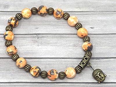 Bracelet pour femme vintage tibétain en perles de jade teinté en orange et noir avec pampille à tête de Bouddha