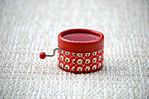 Caja de música manual roja retro con melodías de todos los tiempos II.