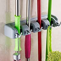4 position and 5 Hooks holder Use in the laundry, garage, garden, utility room, office and more Wall organizer holds household stick goods with handles of varying thicknesses Insert handle into slot and the gravity controlled rolling ball automatical...