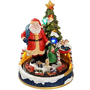 WeRChristmas - Decorazione natalizia con luci LED colorate, 20 cm, soggetto: Babbo Natale vicino all'albero con trenino