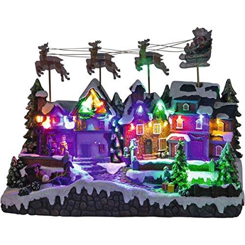 insatech Großes LED Weihnachtsdorf Dorf mit fliegendem Santa Claus und Rentiere ca. 50cm Länge