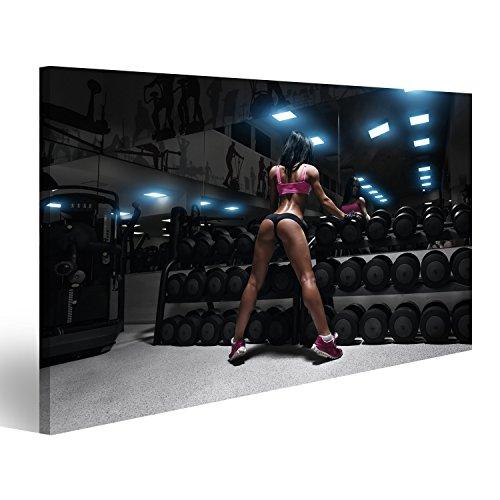 islandburner Bild Bilder auf Leinwand Rückansicht der sexy junge Brünette Frau ruht in der Turnhalle und lehnt auf Reihe von Hanteln. Fitness Mädchen in Fitnessstudio in einem blauen Sport tragen Verschiedene Formate ! Direkt vom Hersteller ! Bilder ! Wandbild Poster Leinwandbilder ! EXP (Mädchen Brünette)