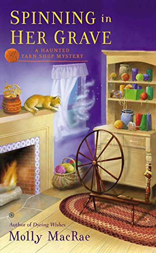 Spinning in Her Grave: A Haunted Yarn Shop Mystery (English Edition)